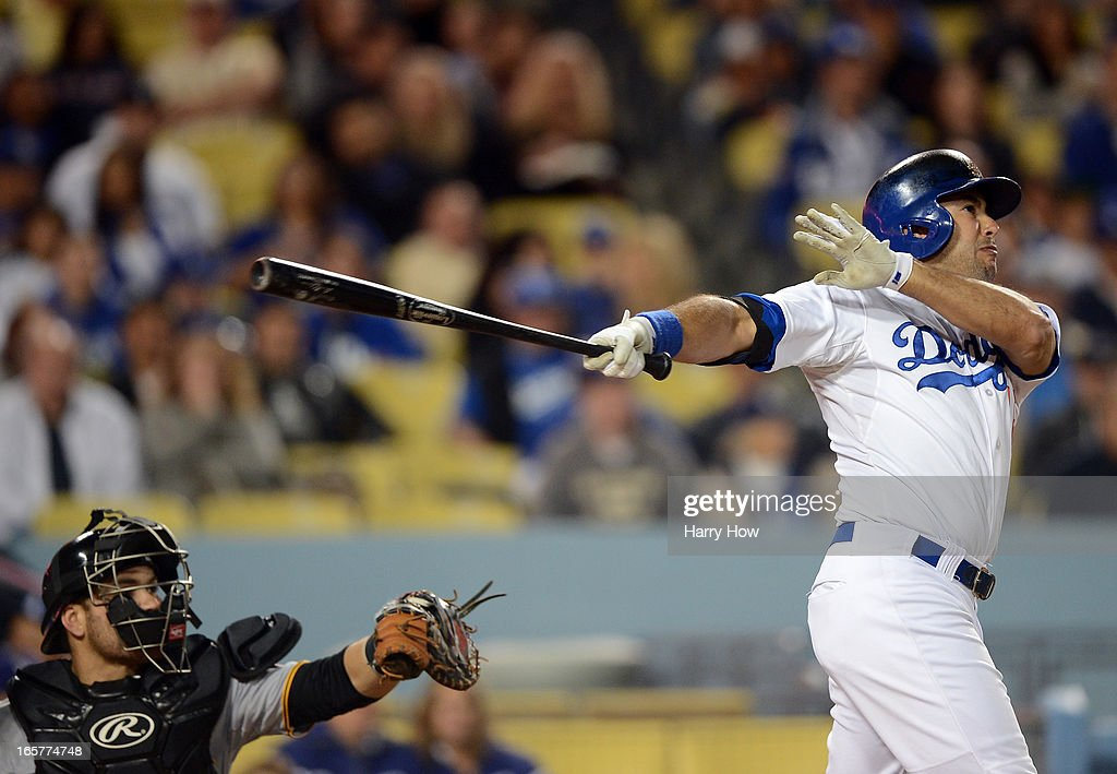 Andre Ethier #16 of the Los Angeles Dodgers hits a solo homerun for a 1-0 lead in front of Russell Martin #55 of the Pittsburgh Pirates during the second inning at Dodger Stadium on April 5, 2013 in Los Angeles, California.