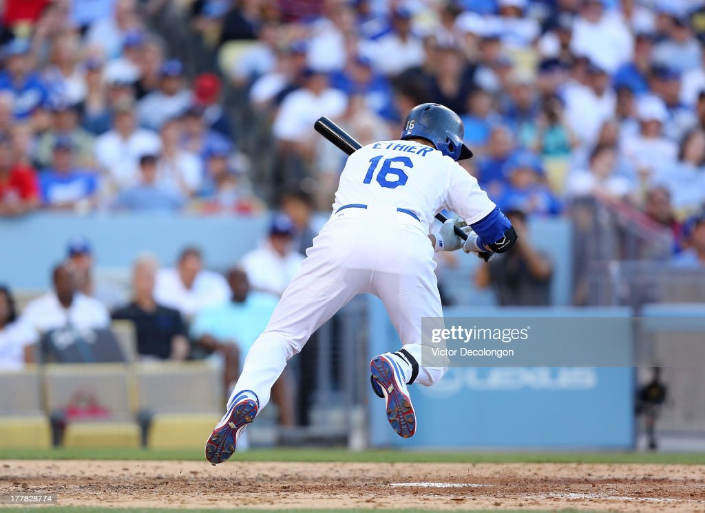 <a gi-track='captionPersonalityLinkClicked' href=/galleries/search?phrase=Andre+Ethier&family=editorial&specificpeople=543213 ng-click='$event.stopPropagation()'>Andre Ethier</a> #16 of the Los Angeles Dodgers jumps to avoid being hit by a pitch by pitcher <a gi-track='captionPersonalityLinkClicked' href=/galleries/search?phrase=Jake+Peavy&family=editorial&specificpeople=211320 ng-click='$event.stopPropagation()'>Jake Peavy</a> #44 of the Boston Red Sox (not in photo) in the fifth inning during their MLB game at Dodger Stadium on August 25, 2013 in Los Angeles, California. The Red Sox defeated the Dodgers 8-1.