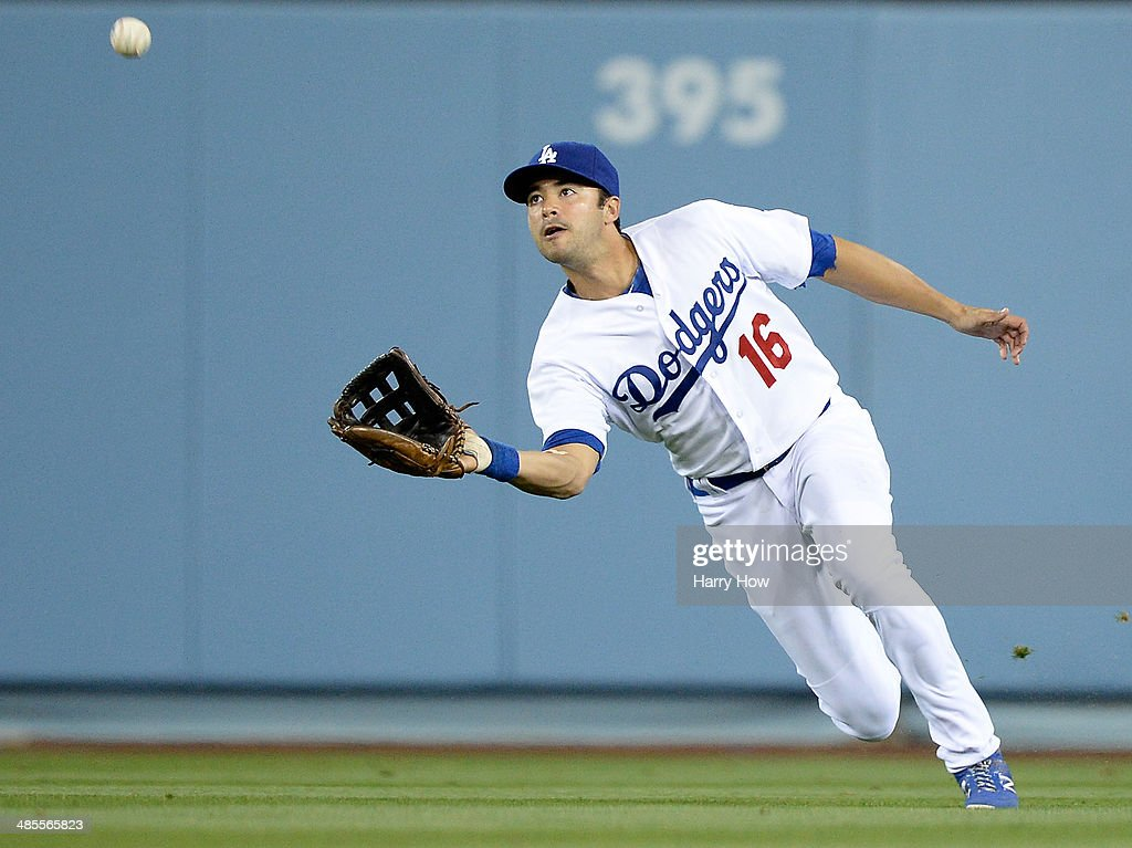 <a gi-track='captionPersonalityLinkClicked' href=/galleries/search?phrase=Andre+Ethier&family=editorial&specificpeople=543213 ng-click='$event.stopPropagation()'>Andre Ethier</a> #16 of the Los Angeles Dodgers makes a catch on Chris Owings #16 of the Arizona Diamondbacks to end the 10th inning at Dodger Stadium on April 18, 2014 in Los Angeles, California.