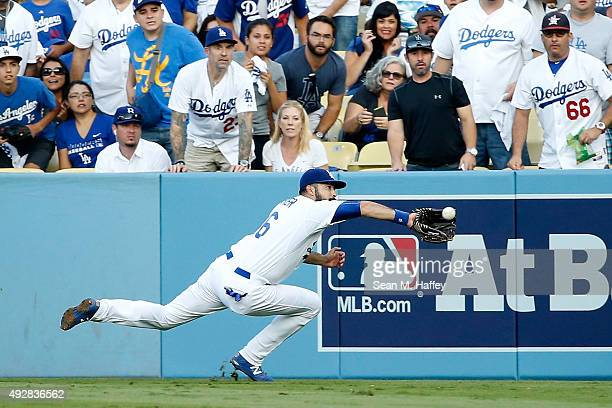 Andre Ethier of the Los Angeles Dodgers makes a diving catch on a ball hit by Michael Conforto of the New York Mets in the second inning in game five...