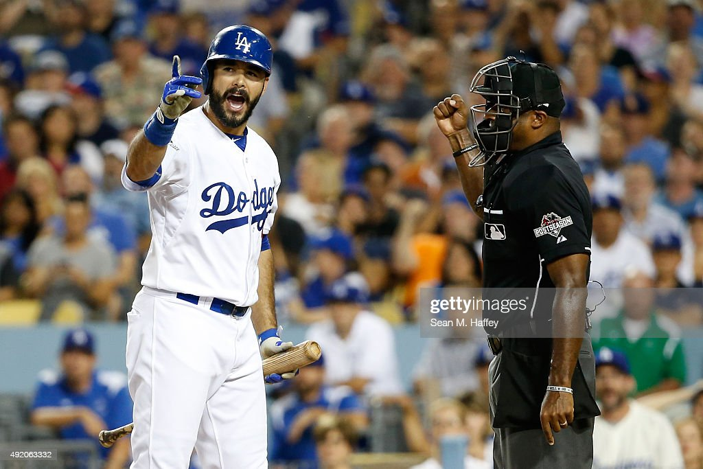 Andre Ethier of the Los Angeles Dodgers reacts after striking out to home plate umpire Alan Porter in game one of the National League Division Series...