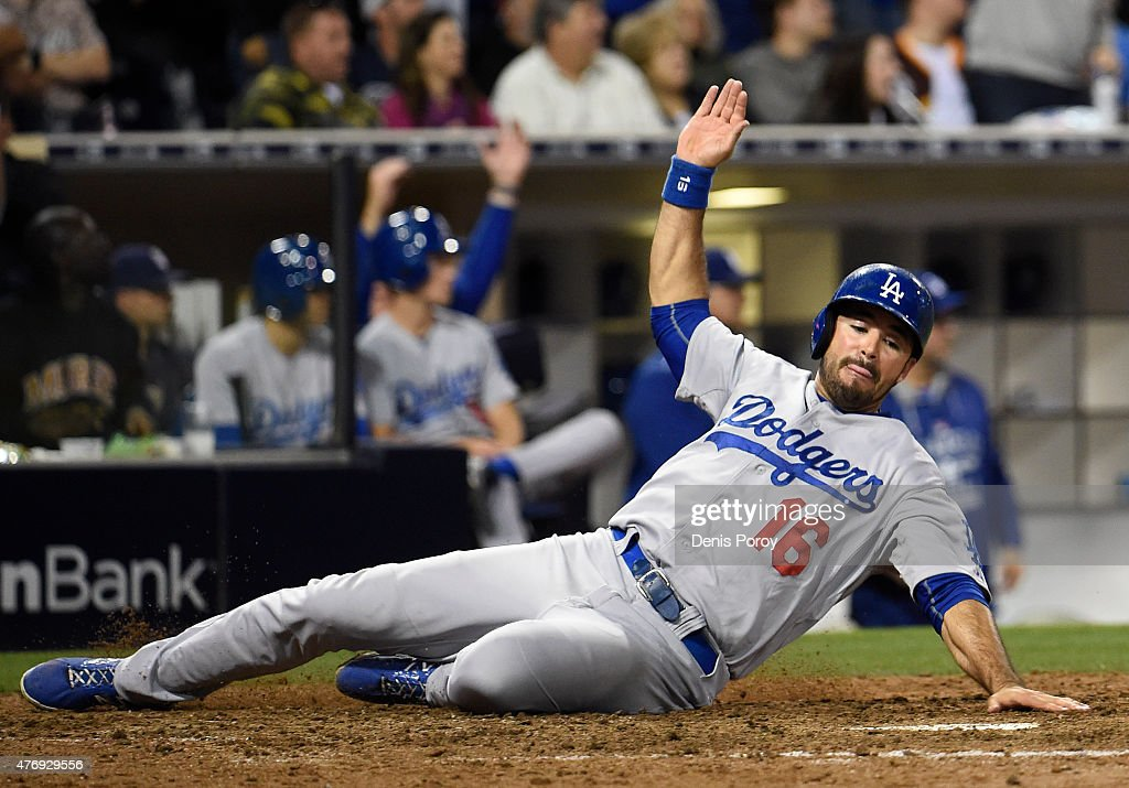 Andre Ethier #16 of the Los Angeles Dodgers slides as he scores during the eighth inning of a baseball game against the San Diego Padres at Petco Park June 12, 2015 in San Diego, California.