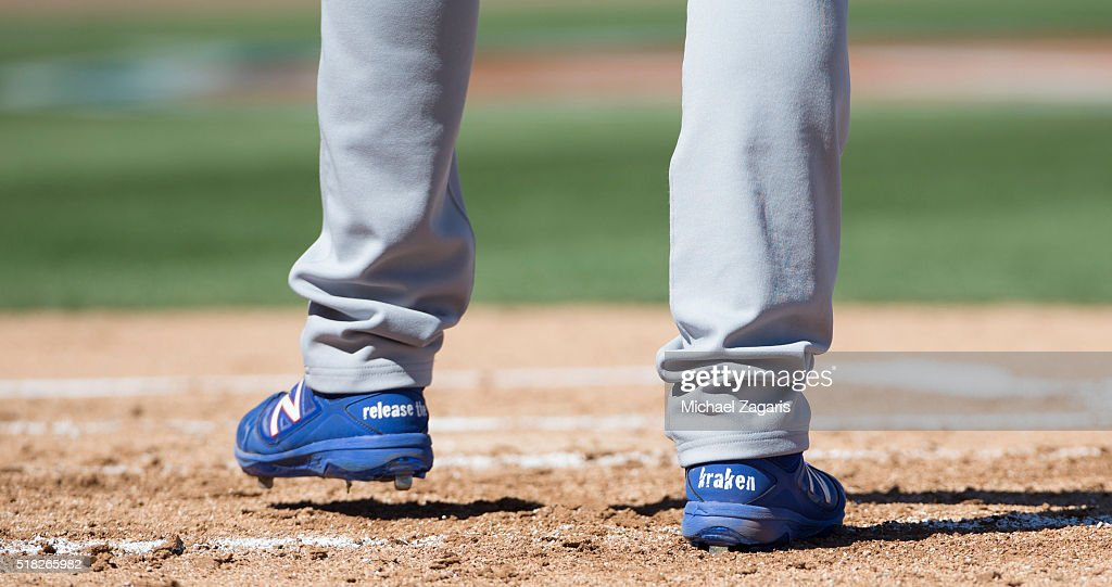 Andre Ethier of the Los Angeles Dodgers wears his 'Release the Kraken' shoes at the plate during a spring training game against the Oakland Athletics...