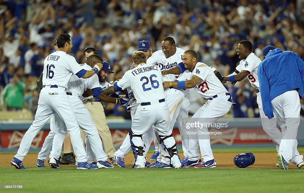 Andre Ethier #16, Yasiel Puig #66, Scott Van Slyke #33, Tim Federowicz #26, <a gi-track='captionPersonalityLinkClicked' href=/galleries/search?phrase=Justin+Turner&family=editorial&specificpeople=550296 ng-click='$event.stopPropagation()'>Justin Turner</a> #10, <a gi-track='captionPersonalityLinkClicked' href=/galleries/search?phrase=Juan+Uribe&family=editorial&specificpeople=209187 ng-click='$event.stopPropagation()'>Juan Uribe</a> #5 and <a gi-track='captionPersonalityLinkClicked' href=/galleries/search?phrase=Matt+Kemp&family=editorial&specificpeople=567161 ng-click='$event.stopPropagation()'>Matt Kemp</a> #27 of the Los Angeles Dodgers mob teammate Carl Crawford #3 after Crawford drove in the game-winning run against pitcher Phil Coke #40 of the Detroit Tigers (not in photo) as teammate <a gi-track='captionPersonalityLinkClicked' href=/galleries/search?phrase=Dee+Gordon&family=editorial&specificpeople=7091343 ng-click='$event.stopPropagation()'>Dee Gordon</a> #9 joins the celebration after their MLB game at Dodger Stadium on April 8, 2014 in Los Angeles, California. The Dodgers defeated the Tigers 3-2 in 10 innings.