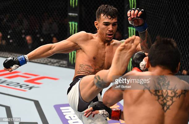 Andre Fili of the United States kicks Gabriel Benitez of Mexico in their featherweight bout during the UFC Fight Night event at Arena Monterrey on...