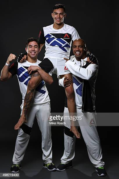 Andre Fili of the United States poses for a portrait with coaches Justin Buchholz and Fabio Prado backstage after his knockout victory over Gabriel...