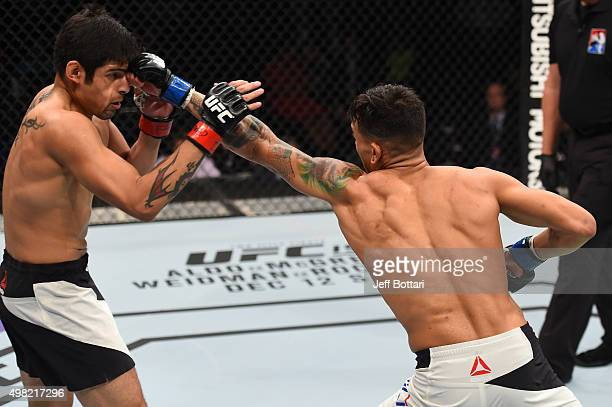 Andre Fili of the United States punches Gabriel Benitez of Mexico in their featherweight bout during the UFC Fight Night event at Arena Monterrey on...