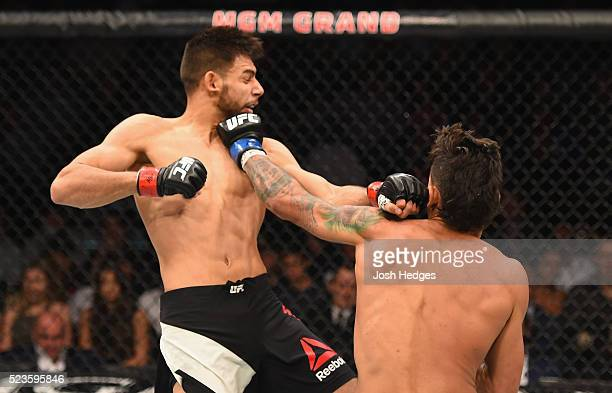 Andre Fili punches Yair Rodriguez of Mexico in their featherweight bout during the UFC 197 event inside MGM Grand Garden Arena on April 23 2016 in...