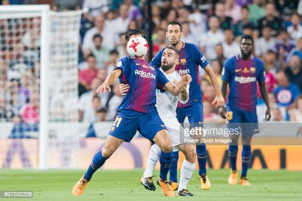 MADRID SPAIN AUGUST 16 Andre Filipe Tavares Gomes of FC Barcelona competes for the ball with Daniel Carvajal Ramos of Real Madrid during their...