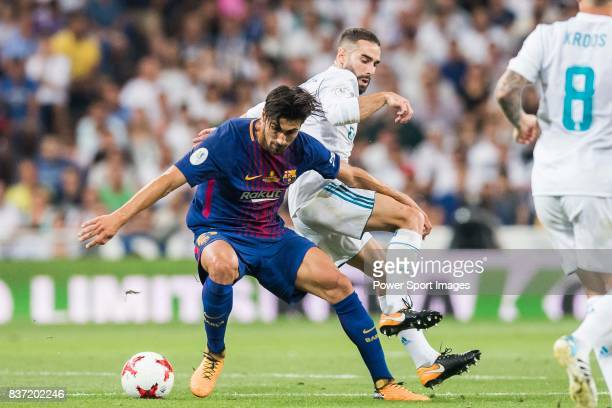 MADRID SPAIN AUGUST 16 Andre Filipe Tavares Gomes of FC Barcelona fights for the ball with Daniel Carvajal Ramos of Real Madrid during their...