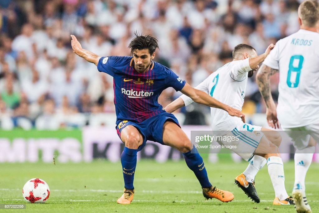 MADRID, SPAIN - AUGUST 16 - Andre Filipe Tavares Gomes (l) of FC Barcelona fights for the ball with Daniel Carvajal Ramos of Real Madrid during their Supercopa de Espana Final 2nd Leg match between Real Madrid and FC Barcelona at the Estadio Santiago Bernabeu on 16 August 2017 in Madrid, Spain.