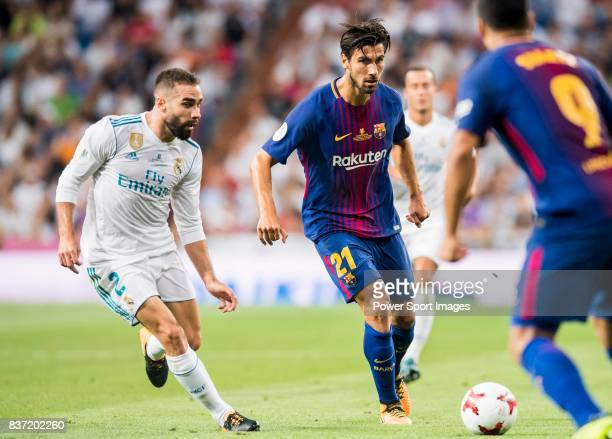 MADRID SPAIN AUGUST 16 Andre Filipe Tavares Gomes of FC Barcelona is followed by Daniel Carvajal Ramos of Real Madrid during their Supercopa de...