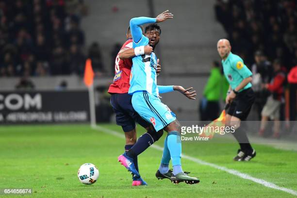 Andre Franck Zambo Anguissa of Marseille and Franck Beria of Lille during the Ligue 1 match between Lille OSC and Olympique de Marseille at Stade...