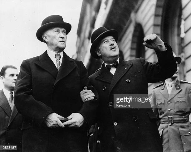 Andre Francois Poncet the French High Commissioner in Germany guides German President Konrad Adenauer during his visit to Paris