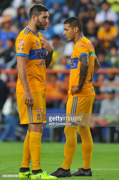 Andre Gignac and Victor Sosa of Tigres receive instructions during their Mexican Apertura 2017 Tournament football match at Hidalgo stadium on August...