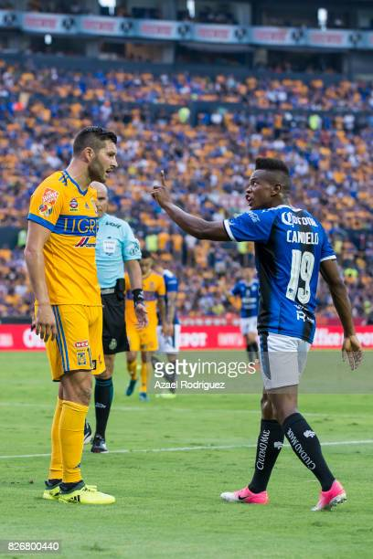 Andre Gignac of Tigres argues with Yerson Candelo of Queretaro during the 3rd round match between Tigres UANL and Puebla as part of the Torneo...