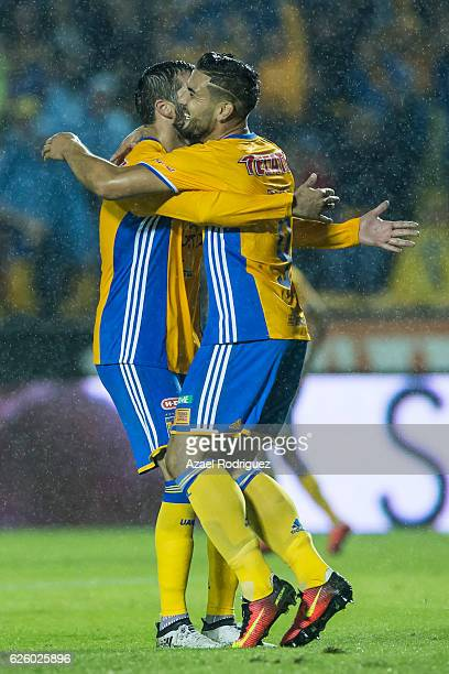Andre Gignac of Tigres celebrate with teammate Andy Delort after scoring his team's fourth goal during the quarter finals second leg match between...