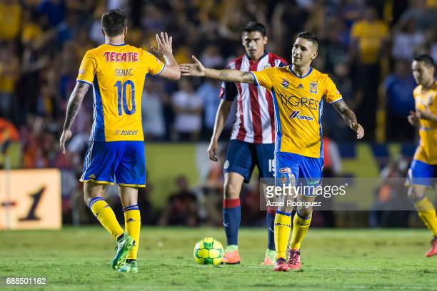 Andre Gignac of Tigres celebrate with teammate Ismael Sosa after scoring his team's first goal during the Final first leg match between Tigres UANL...