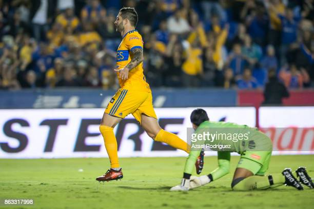 Andre Gignac of Tigres celebrates after scoring his team's first goal over Edgar Hernandez goalkeeper of Veracruz during the 10th round match between...