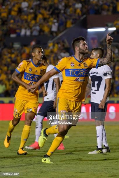 Andre Gignac of Tigres celebrates after scoring his team's second goal during the 5th round match between Tigres and Pumas as part of the Torneo...