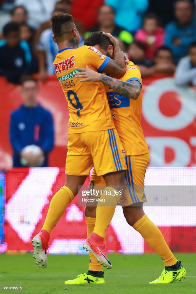 Andre Gignac of Tigres celebrates with Eduardo Vargas after scoring the first goal of his team during the 4th round match between Pachuca and Tigres UANL as part of the Torneo Apertura 2017 Liga MX at Hidalgo Stadium on August 12, 2017 in Pachuca, Mexico.