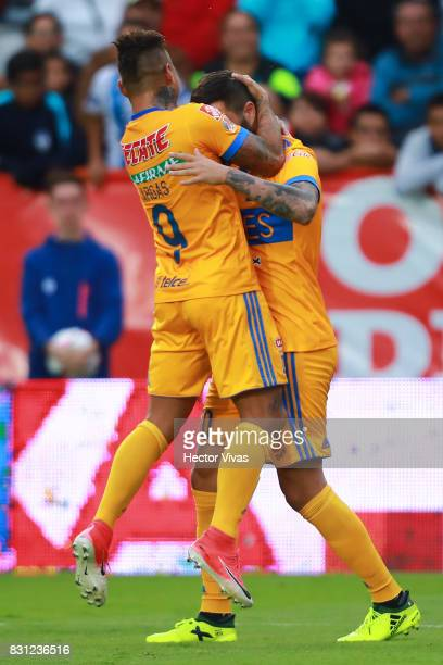 Andre Gignac of Tigres celebrates with Eduardo Vargas after scoring the first goal of his team during the 4th round match between Pachuca and Tigres...
