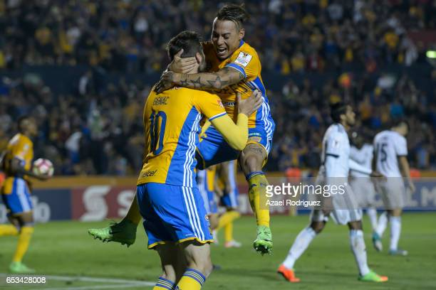 Andre Gignac of Tigres celebrates with teammate Eduardo Vargas after Kendall Waston of Vancouver scored an own goal during the semifinals first leg...