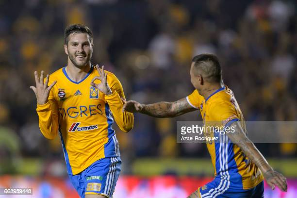 Andre Gignac of Tigres celebrates with teammate Eduardo Vargas after scoring his team's fourth goal during the 14th round match between Tigres UANL...