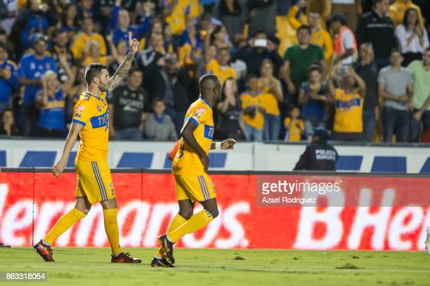 Andre Gignac of Tigres celebrates with teammate Enner Valencia after scoring his team's first goal during the 10th round match between Tigres UANL...