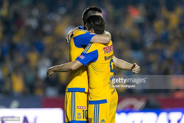 Andre Gignac of Tigres celebrates with teammate Rafael Sobis after scoring his team's third goal during the fourth round match between Tigres and...