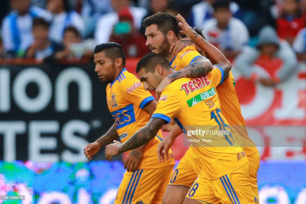 Andre Gignac of Tigres celebrates with teammates after scoring the first goal of his team during the 4th round match between Pachuca and Tigres UANL as part of the Torneo Apertura 2017 Liga MX at Hidalgo Stadium on August 12, 2017 in Pachuca, Mexico.