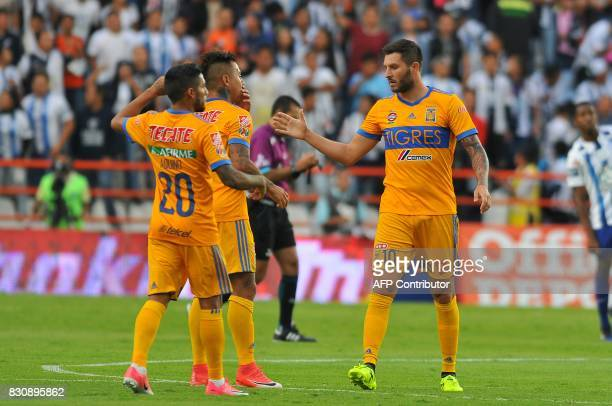 Andre Gignac of Tigres celebrates with teammates his goal against Pachuca during their Mexican Apertura 2017 Tournament football match at Hidalgo...