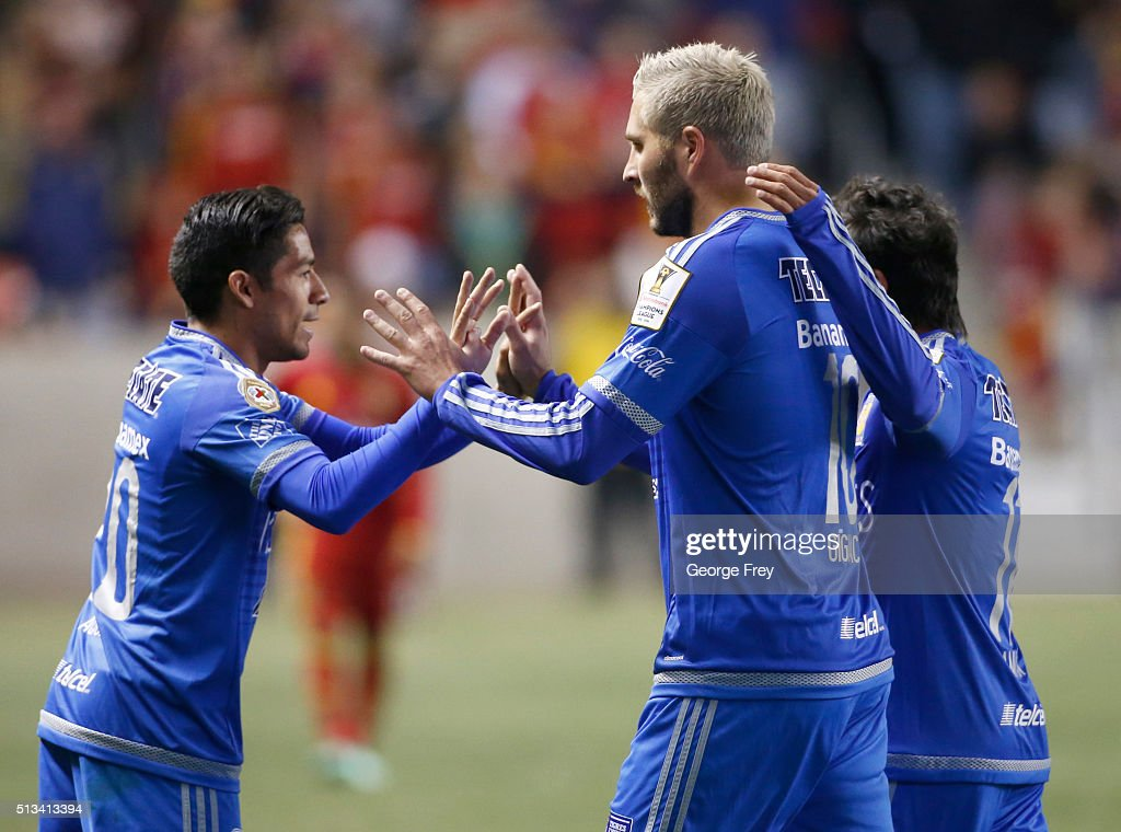 Andre Gignac of Tigres celebrates with teammates Javier Aquino and Damian Alvarez after scoring the tying goal during the quarterfinals second leg...