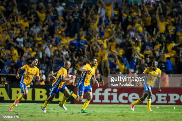 Andre Gignac of Tigres celebrates with teammates Jurgen Damm Luis Rodriguez and Luis Advincula after scoring his team's second goal during the Final...