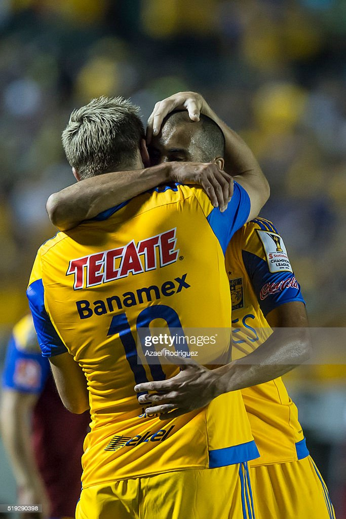 Andre Gignac of Tigres celebratess with teammate Guido Pizarro after scoring his team's first goal during the semifinals second leg match between...