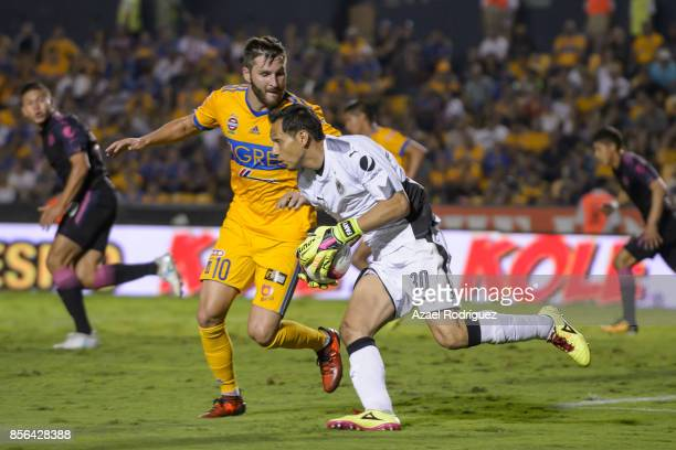 Andre Gignac of Tigres chases Rodolfo Cota goalkeeper of Chivas during the 12th round match between Tigres UANL and Chivas as part of the Torneo...