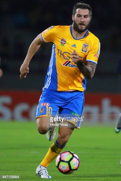 Andre Gignac of Tigres drives the ball during the quarterfinals second leg match between Pumas UNAM and Tigres UANL as part of the CONCACAF Champions...