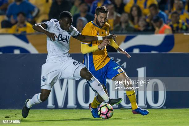 Andre Gignac of Tigres fights for the ball with Alphonso Davies of Vancouver Whitecaps during the semifinals first leg match between Tigres UANL and...