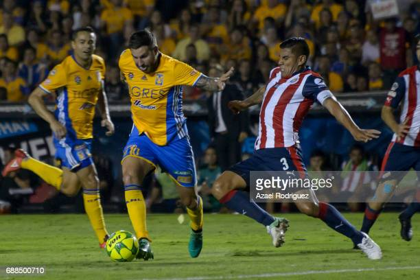 Andre Gignac of Tigres fights for the ball with Carlos Salcido of Chivas during the Final first leg match between Tigres UANL and Chivas as part of...