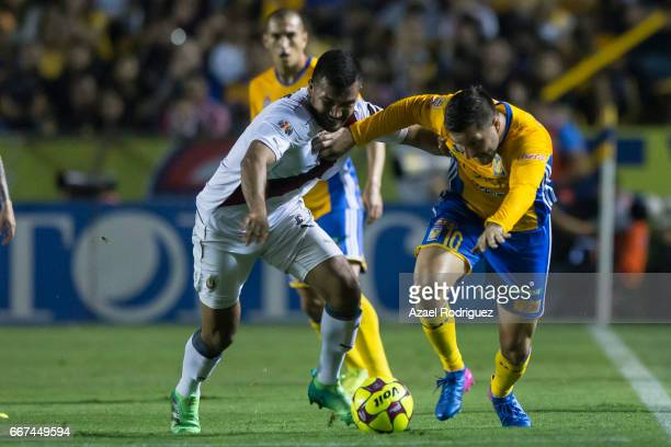 Andre Gignac of Tigres fights for the ball with Hedgardo Marin of Chivas during the match between Tigres and Chivas as part of the Clausura 2017 Liga...