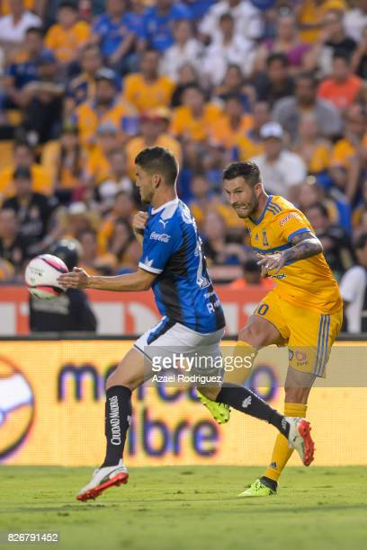 Andre Gignac of Tigres fights for the ball with Hiram Mier of Queretaro during the 3rd round match between Tigres UANL and Puebla as part of the...