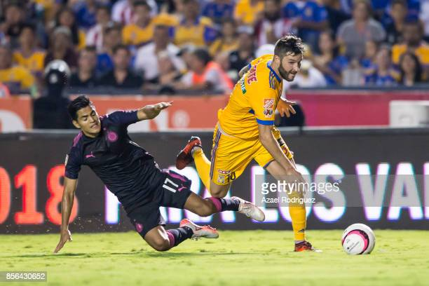 Andre Gignac of Tigres fights for the ball with Jesus Sanchez of Chivas during the 12th round match between Tigres UANL and Chivas as part of the...