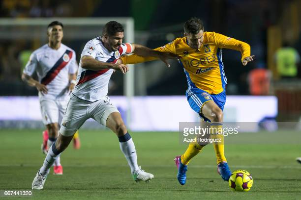 Andre Gignac of Tigres fights for the ball with Juan Basulto of Chivas during the match between Tigres and Chivas as part of the Clausura 2017 Liga...