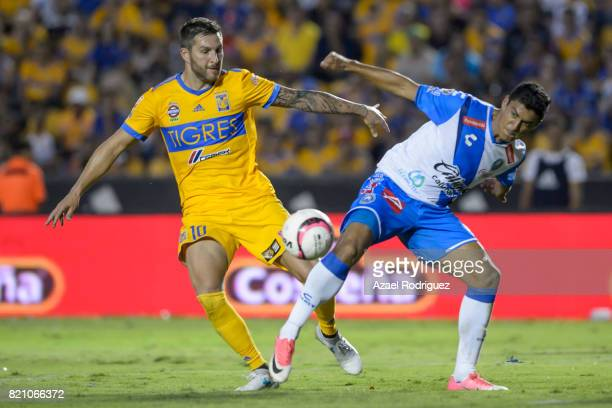 Andre Gignac of Tigres fights for the ball with Luis Venegas of Puebla during the 1st round match between Tigres UANL and Puebla as part of the...