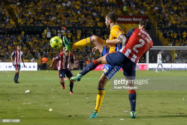 Andre Gignac of Tigres fights for the ball with Oswaldo Alanis of Chivas during the Final first leg match between Tigres UANL and Chivas as part of...