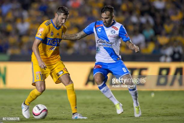 Andre Gignac of Tigres fights for the ball with Pablo Miguez of Puebla during the 1st round match between Tigres UANL and Puebla as part of the...