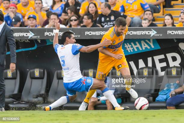Andre Gignac of Tigres fights for the ball with Patricio Araujo of Puebla during the 1st round match between Tigres UANL and Puebla as part of the...