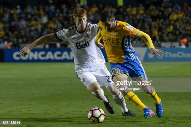 Andre Gignac of Tigres fights for the ball with Tim Parker of Vancouver Whitecaps during the semifinals first leg match between Tigres UANL and...