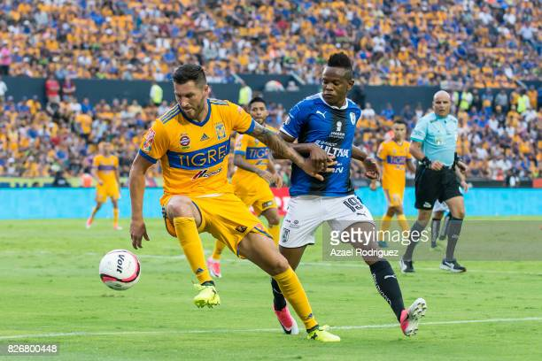 Andre Gignac of Tigres fights for the ball with Yerson Candelo of Queretaro during the 3rd round match between Tigres UANL and Puebla as part of the...