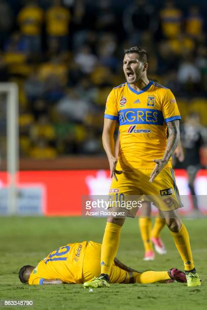 Andre Gignac of Tigres reacts while teammate Ismael Sosa lies on the ground during the 10th round match between Tigres UANL and Veracruz as part of...